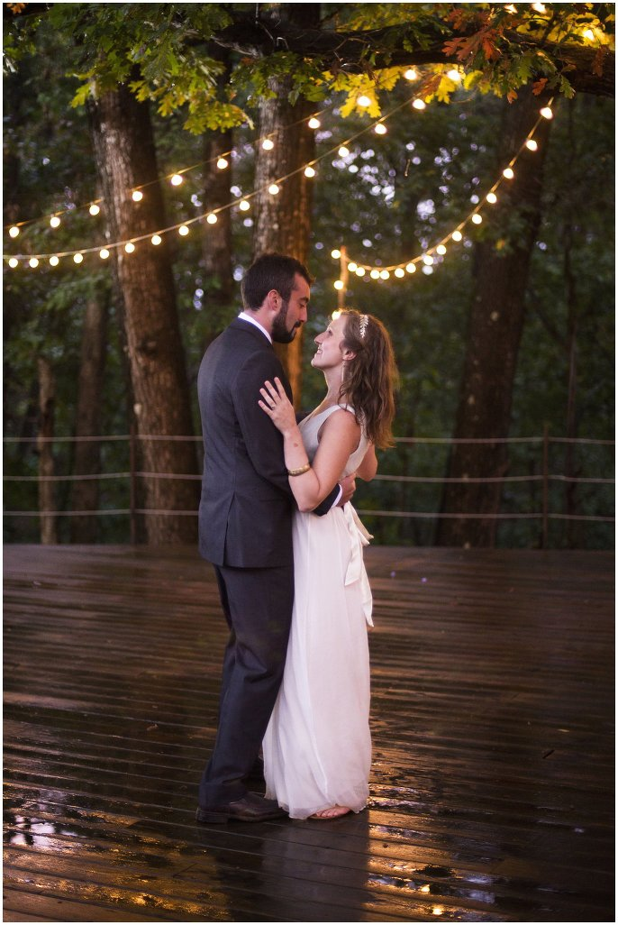 bride and groom dancing under  market lights photo