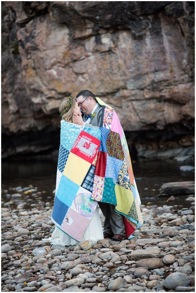 intimate couple in quilt Lyons River wedding photo