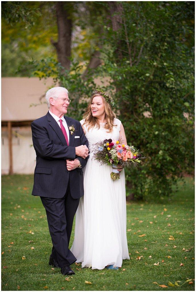 bride and dad walking down aisle colorado mountain wedding photo