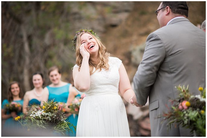 emotional bride saying vows colorado mountain wedding photo