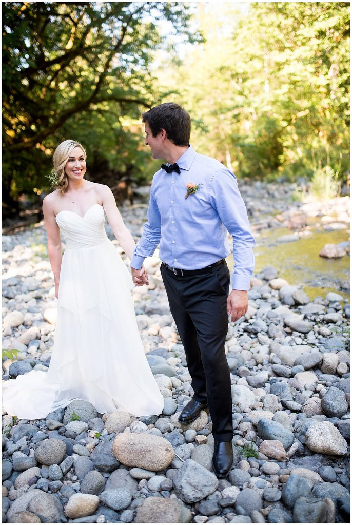 couple by river in washington elopement photo