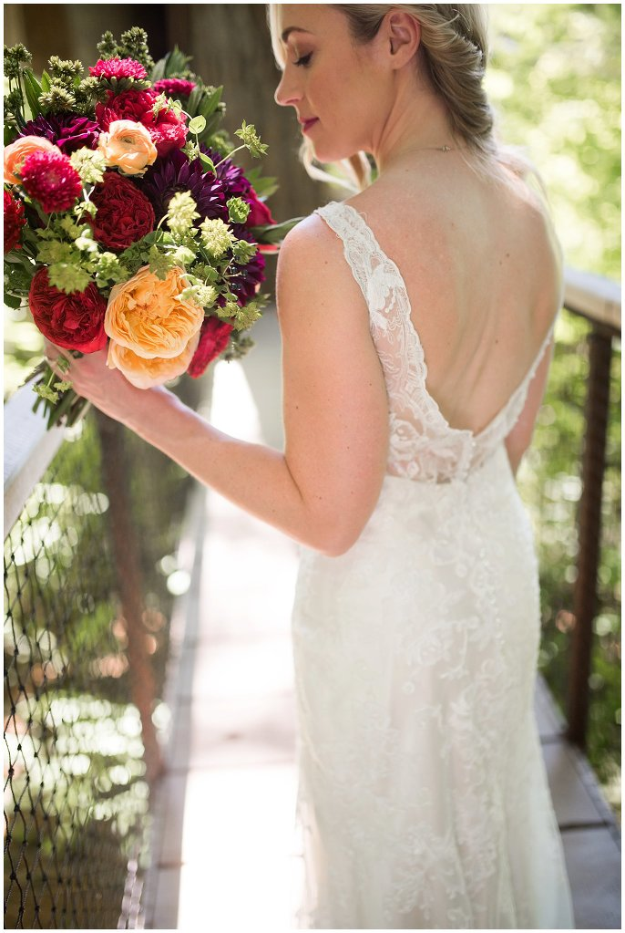 vibrant blooms bride in treehouse in lace dress photo