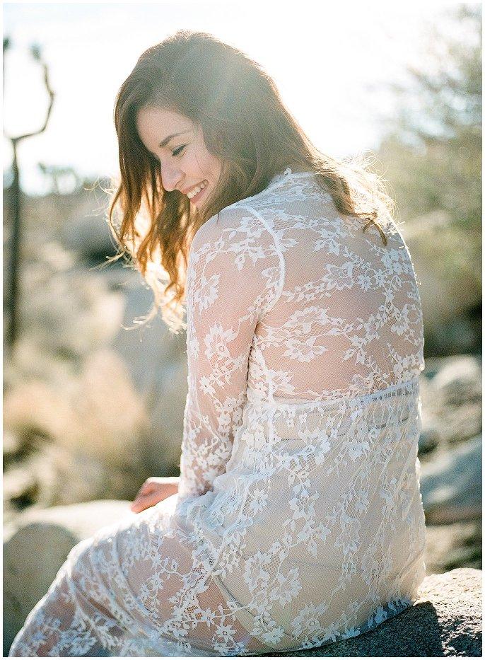 woman laughing in lace dress desert boudoir photo