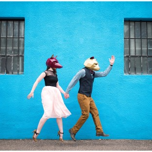 couple wearing Wintercroft Masks for Denver RiNo engagement photo