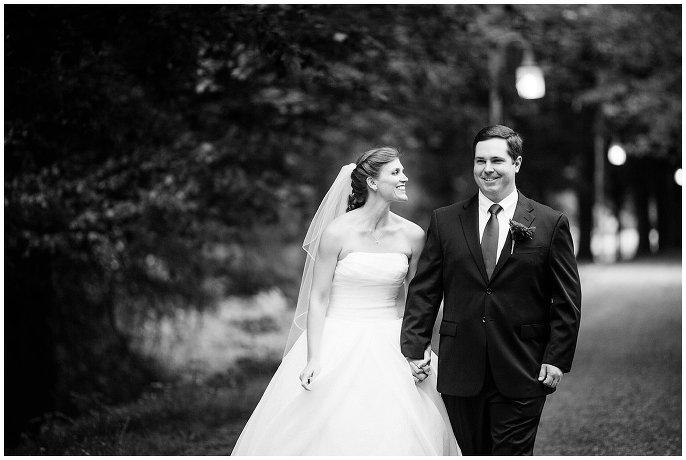 wedding couple walking on treelined path in Old Salem photo
