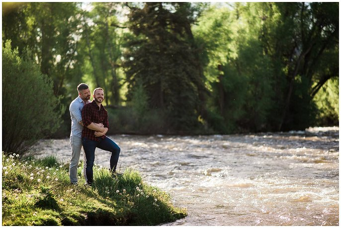 lgbt engagement photo by river