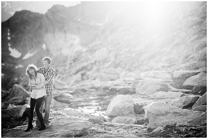 engaged couple laughing in Colorado mountains