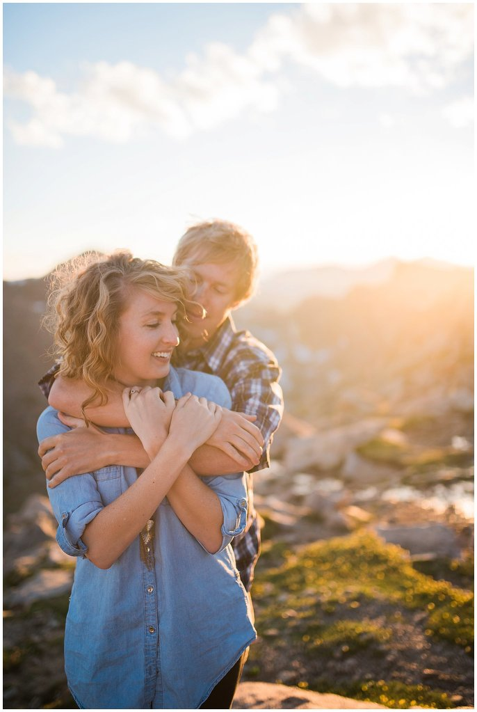 couple snuggling in the Colorado mountains photo