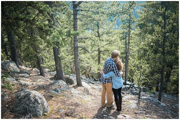 couple in mountains with evergreens photo