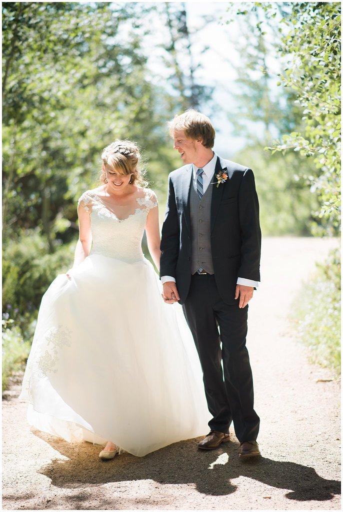 bride and groom walking in colorado aspen grove photo