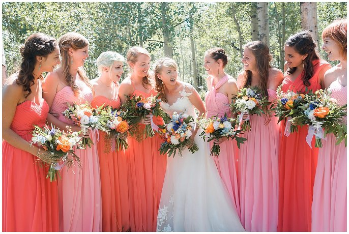 bridesmaids in shades of coral photo