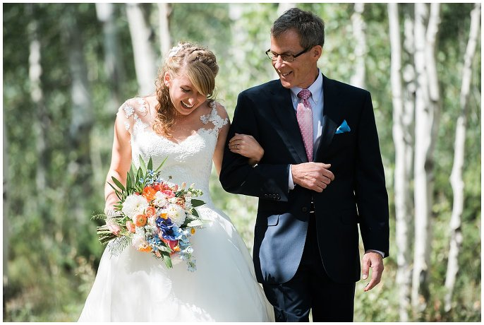 bride walking down aisle with father at Granby Ranch wedding photo