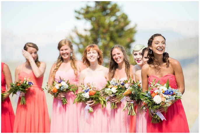 bridesmaids in mismatched coral wedding dresses photo