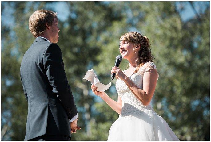 bride reading vows at Colorado mountain wedding photo