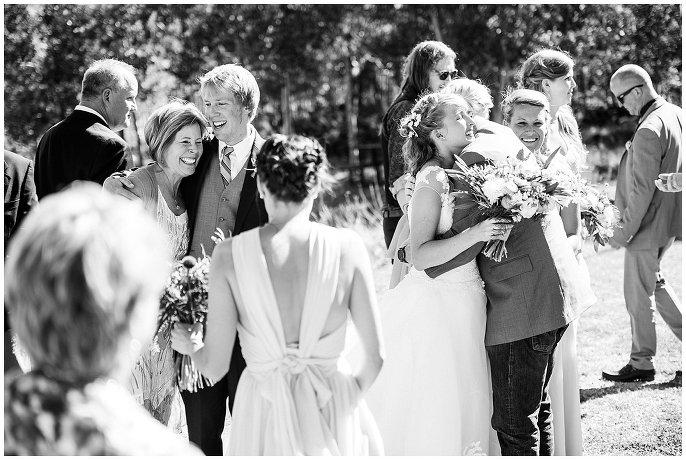 family hugs wedding photojournalism colorado mountain wedding photo