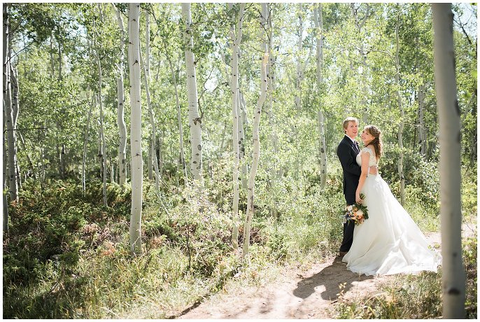 bride and groom in aspens at Granby Ranch photo
