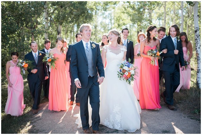 bridal party walking in aspen grove Granby Ranch wedding photo