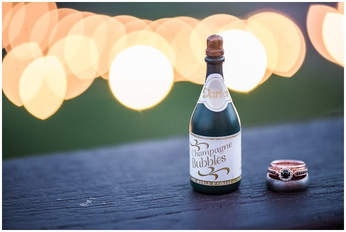 black engagement ring with mini champagne bottle photo
