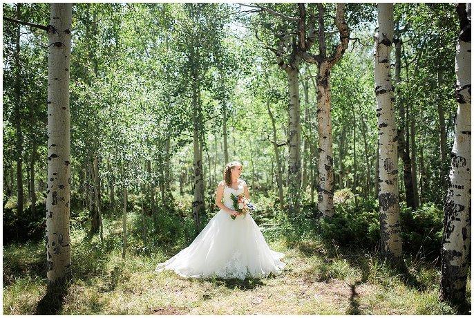 bride in lace wedding dress in aspen grove photo