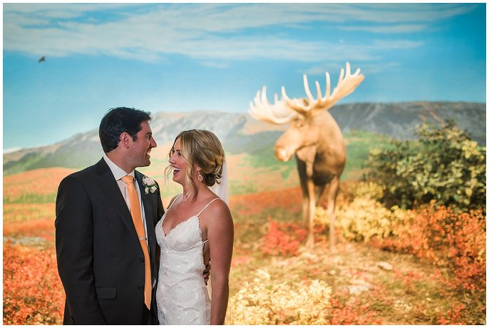 couple in diorama hall at Denver Museum of Nature and Science wedding photo