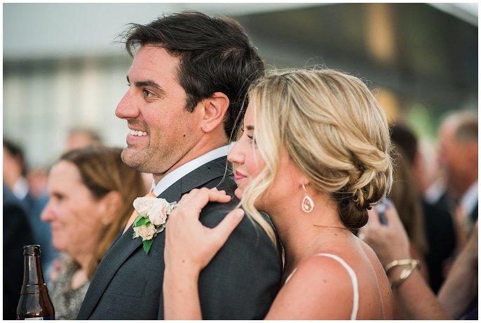 couple cuddled during wedding day toasts photo