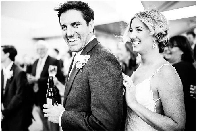 couple laughing during wedding day toasts photos
