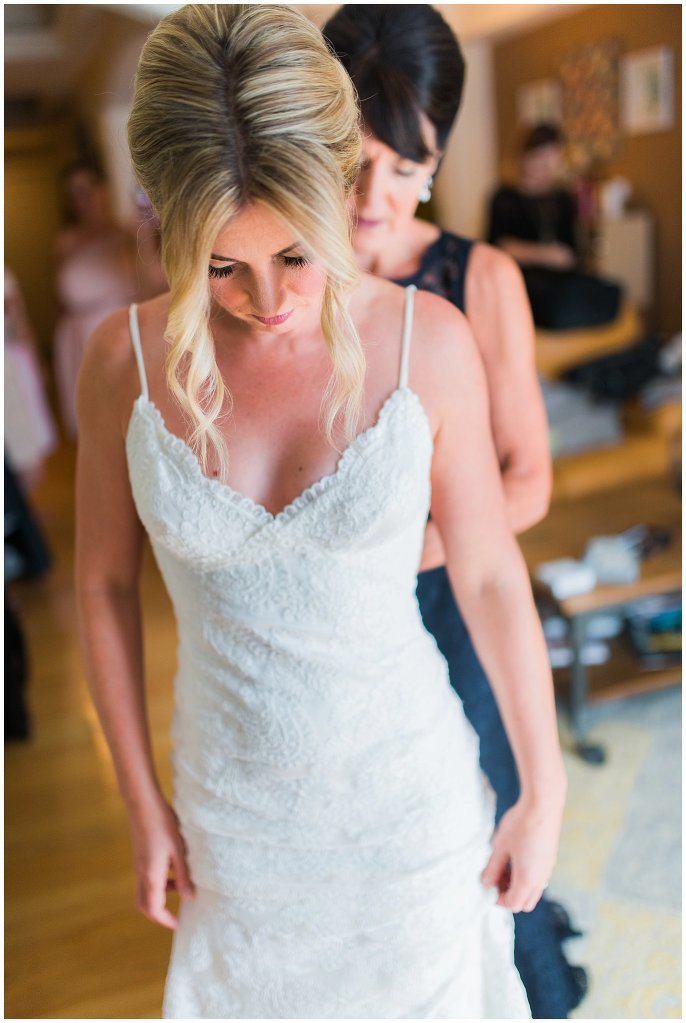 bride in lace sheeth wedding dress photo