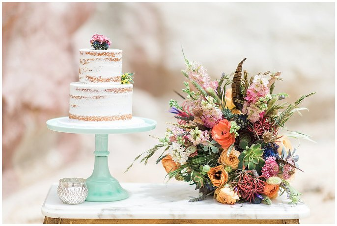 naked cake and bouquet with feathers and succulents