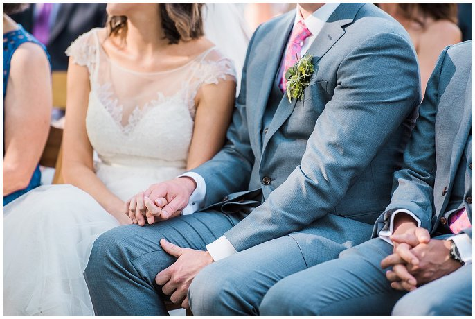 couple holding hands during ceremony photo