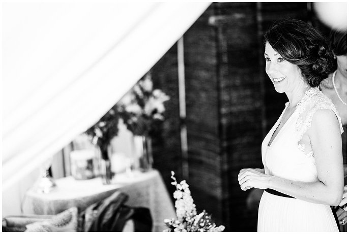 bride getting ready in glamping tent photo