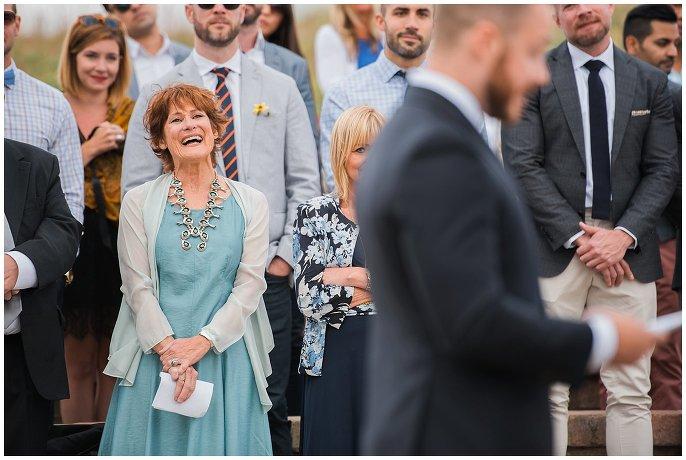 mom celebrating at gay wedding vows