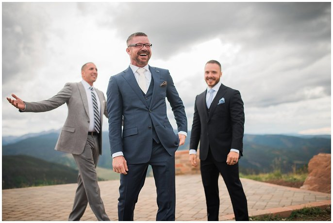 grooms celebrating wedding at top of Vail mountain photo