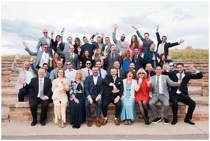 weddings guests cheering at top of colorado mountain photo
