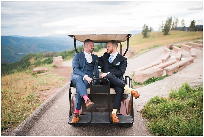 grooms riding in golf cart on top of Vail Wedding Deck