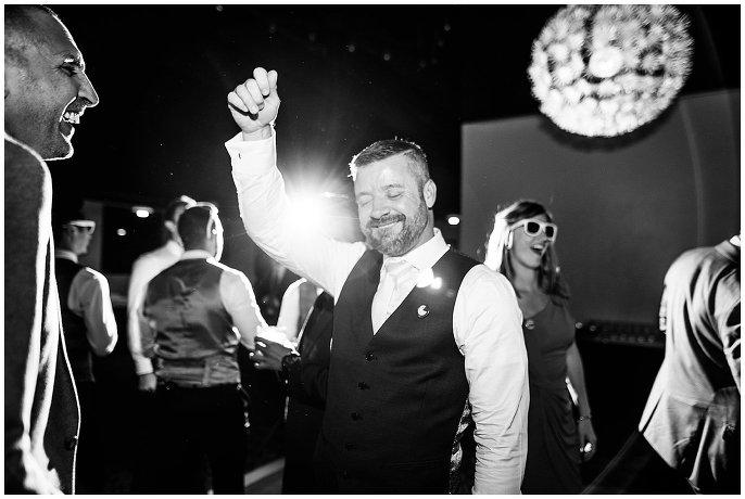 grooms dancing at same-sex wedding