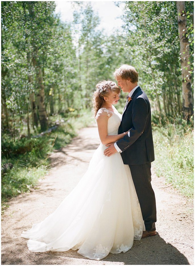 couple in aspens at Granby wedding photo