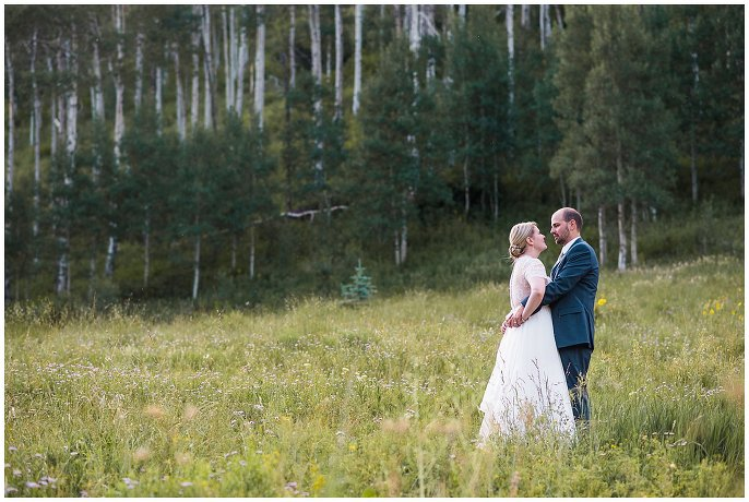 bride and groom in aspens on Colorado mountain photo