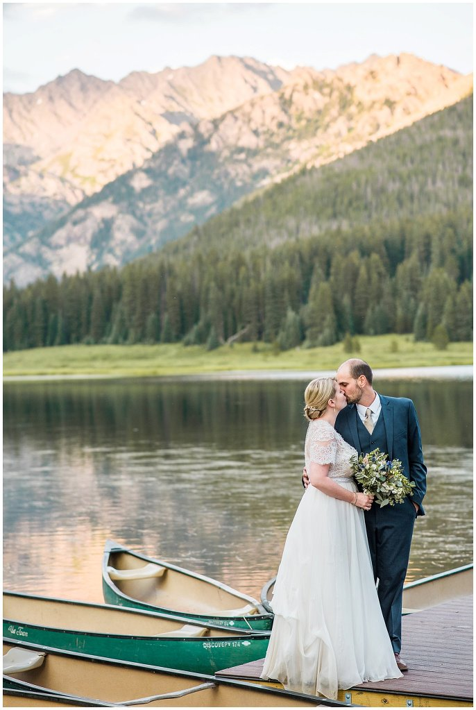 couple kissing by Colorado mountain photo