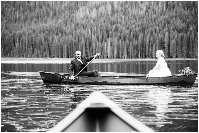 bride and groom out on lake on wedding day photo