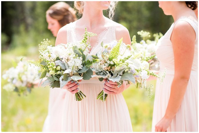 wildflower bouquets and blush bridesmaid dresses photo