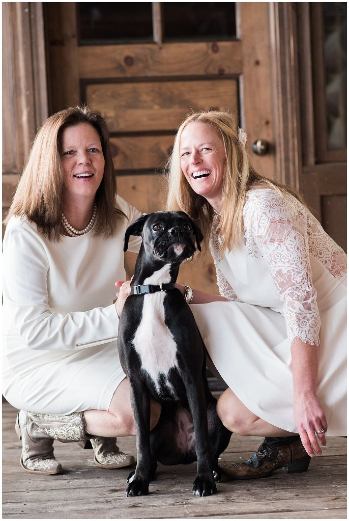 brides with dog on wedding day photo