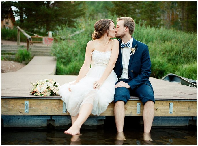 bride and groom barefoot in lake photo