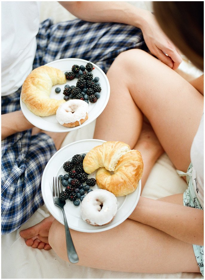 berries and donuts breakfast in bed photo