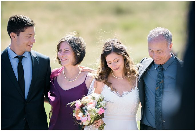 bride walked down aisle by entire family photo