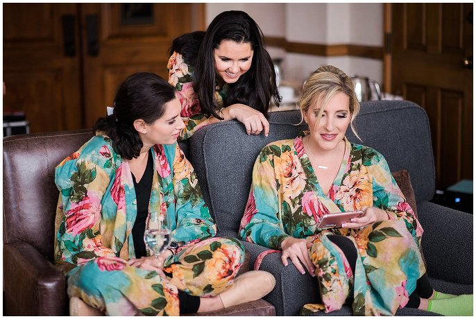 bridesmaids in matching flowery robes